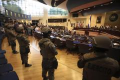 In this Feb. 9, 2020 file photo, armed Special Forces soldiers of the Salvadoran Army, following orders of President Nayib Bukele, enter congress upon the arrival of lawmakers, in San Salvador, El Salvador. Opposition lawmakers recommended on Thursday, Dec. 17, 2020, that President Bukele dismiss the director of the National Police and the chief of the armed forces, because of serious human rights violations that occurred when the armed forces entered congress.